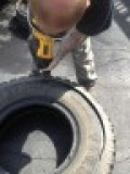 Very carefully trim away the inner top layer of the tire using a sawsall
