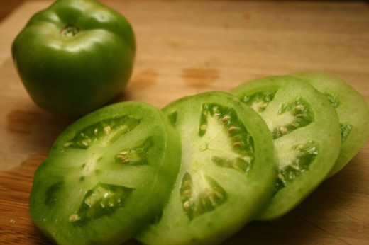 sliced green tomatoes, ready to be breaded and fried