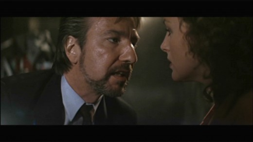 Hans Gruber and Holly having a chit chat