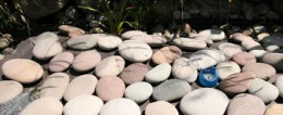 The children who have passed away have their names on these pebbles of love.