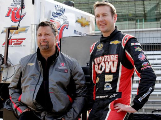Indy team owner Michael Andretti, with Busch