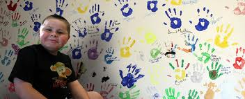 Proudly presenting these colourful handprints.