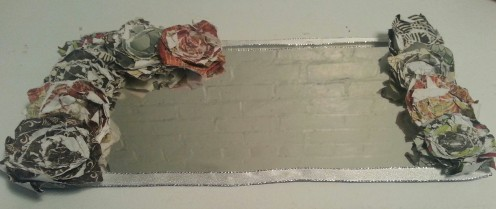 Paired with silver wired ribbon, these roses were used to embellish a mirror.