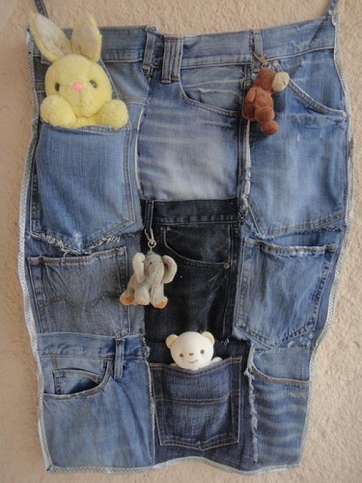 Denim pockets from old jeans cut up and sewn together lengthwise make a nifty FE! Just sew any holes in the pockets and find those big enough to store those gifts!