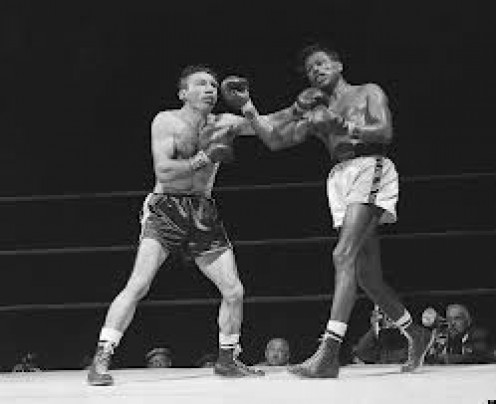 Carmen Basilio beat Sugar Ray Robinson for the middleweight crown in the biggest win of his career.