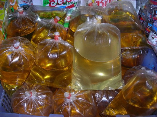 Vegetable oil in plastic bags for sale in Thailand.