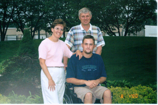 in 2000, w/parents= wheelchair bound