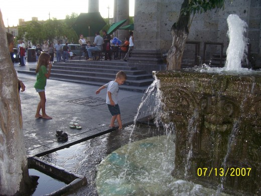 Author's children playing in the Plaza Tapatia, Guadalajara