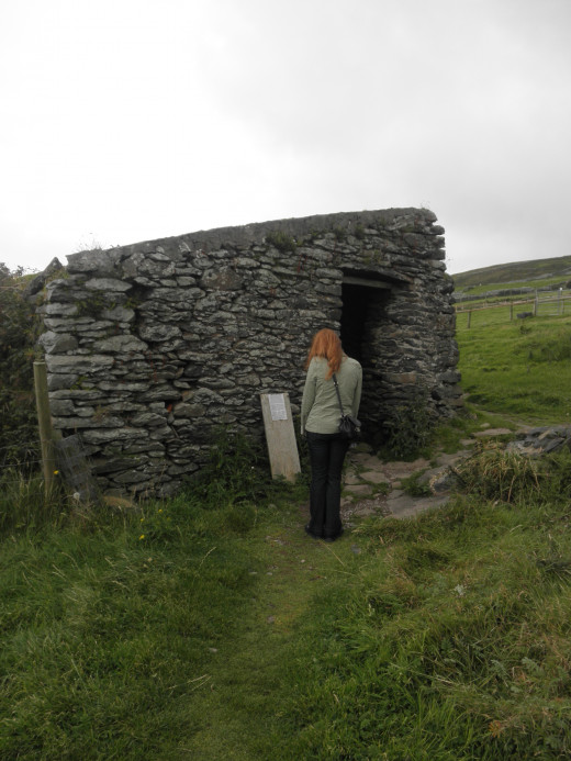 Me reading a bit of the history of the Famine Cottage