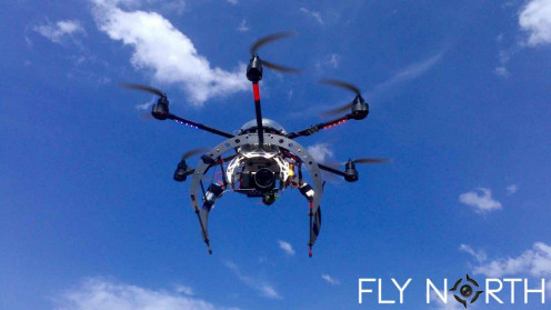 A hexacopter from Fly North taking into the air.