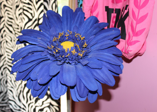 One large fake flower is a simple alternative to the classic bouquet.