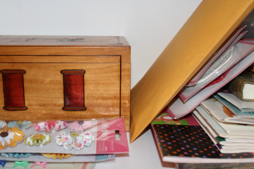 The gorgeous, hand-carved wooden box contains collage supplies.