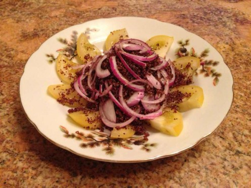 Kañiwa grain with yellow tomatoes, red onions, and olive oil