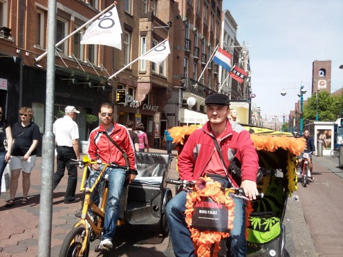 Amsterdam bicycle taxi drivers on the Damrak, near Dam Square