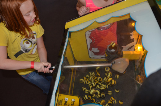 Our grand daughter scooping bees into the hive in an arcade game