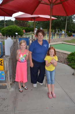 Our girls with Margaret White, Owner of Papio Fun Park.  The girls rate the park with 2 thumbs up!