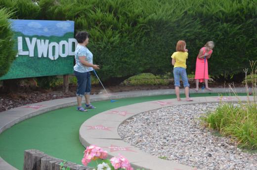Our family mini-golfing through Hollywood at Papio Fun Park