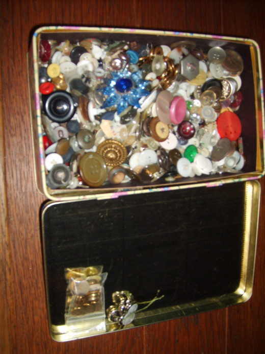 The box pictured above, open and showing the assortment of buttons.