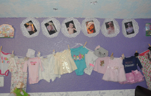 We had several paper doilies we were not using so they became photo mats and we hung up baby clothes she could no longer wear.