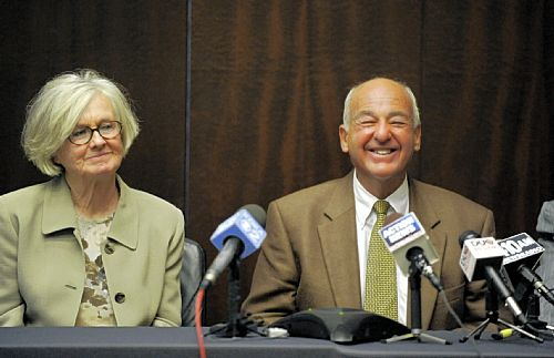 Dr. Cyril H. Wecht, seated by his wife Sigrid Wecht, speaks at a news conference about the dismissal of all charges against him.
