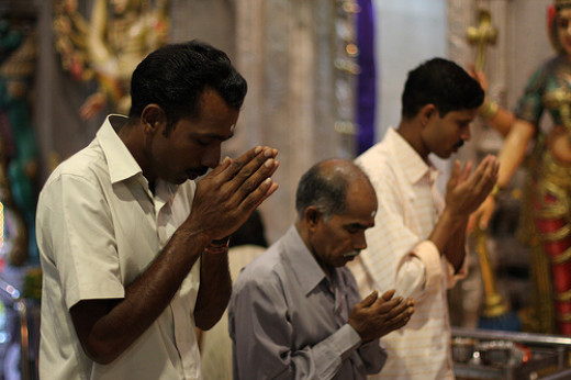 Singaporean/Malaysian Indians offering prayers in a Hindu temple