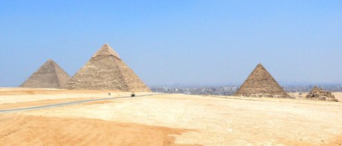 The Great Pyramids of Giza. Pyramid of Khufu located at the far left. and is the largest of all three. The pyramid of Khafre located at the middle and the pyramid of Menkaure located at the far right side of the picture,