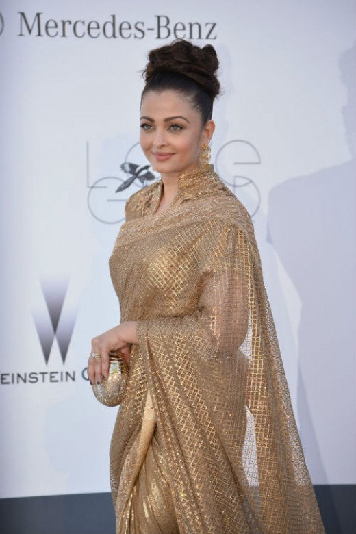 Aishwarya Rai in golden saree.