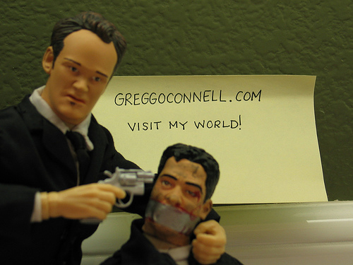An action figure of Tarantino tortures a plastic cop, Reservoir Dogs style.  Will he do his own torture next movie?