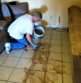 Applying the grout is the easy part. The hard part is sponging away the excess before it dries.
