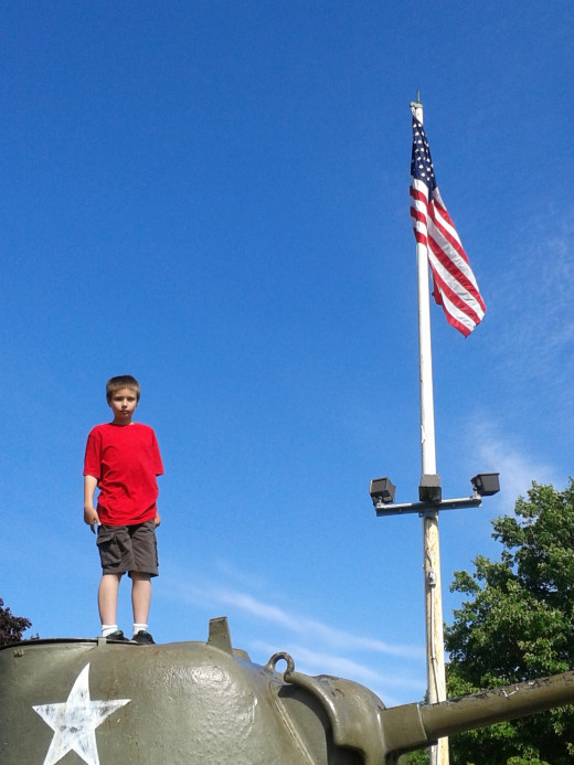 Jeffrey Standing Guard On A WWII Tank!
