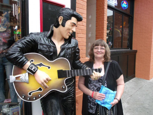 This picture was taken in Nashville of me and a statue of Elvis. It is the one in the mosaic.