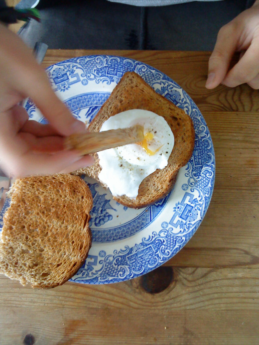 Poached egg with toast soldiers.