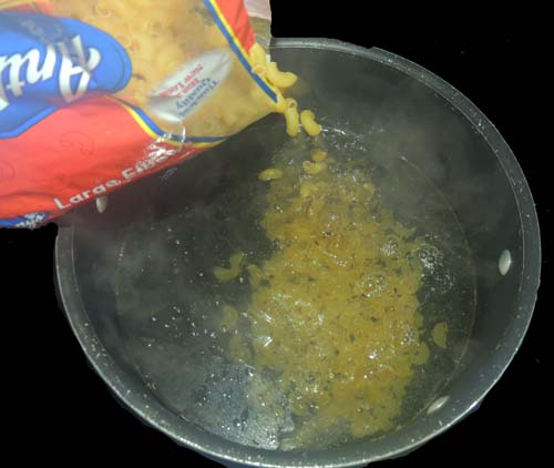 add macaroni to boiling water, and cook to al dente--note: this can be done at any time during prep