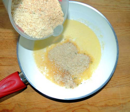 add mix of Panko and Progresso breadcrumbs to melted butter, and stir