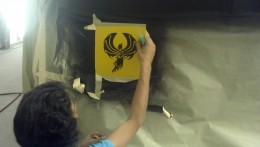 Michele installing the trademark 'Phoenix' of Phoenix Commercial Paint Inc