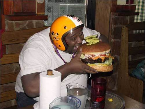 Obese man with burger. Click on this picture to make it bigger.