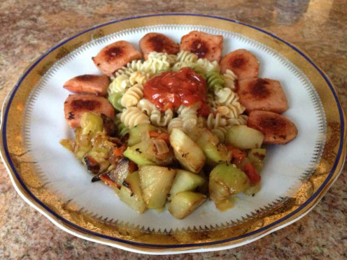 Entree - veal knockwurst with vegetable radiatore pasta, and sauteed chayote squash