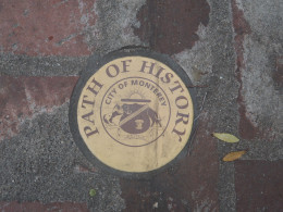 The gold plates mark the history walking tour path in Monterey, California.