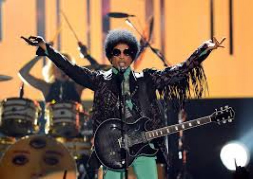 Prince brings the rain. The Purple Rain. He started out rocking stages in the 1980's and he can still fill stadiums up now.