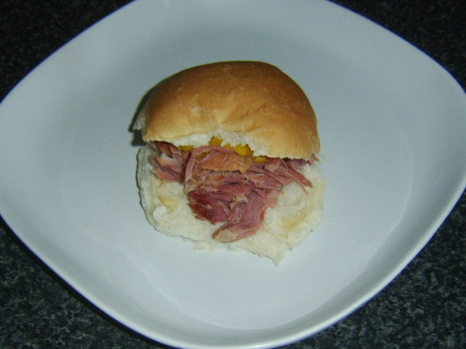 Warm roast ham and piccalilli bread roll