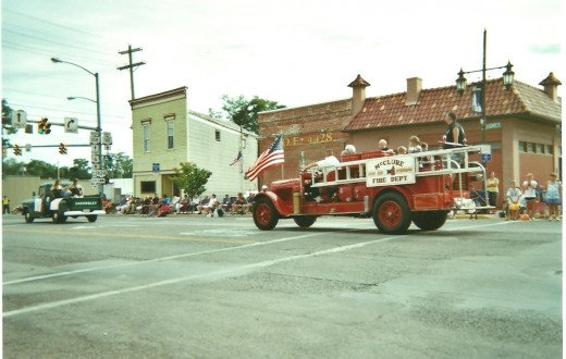 An ancient fire truck from McClure, Ohio, takes part in the Tomato Festival Parade and Pageant in downtown Napoleon on its way to the fairgrounds for the 159th Henry County Fair, 2012.