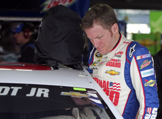 Dale Earnhardt Jr. gets into the car at Michigan. His day ended early thanks to a blown tire.