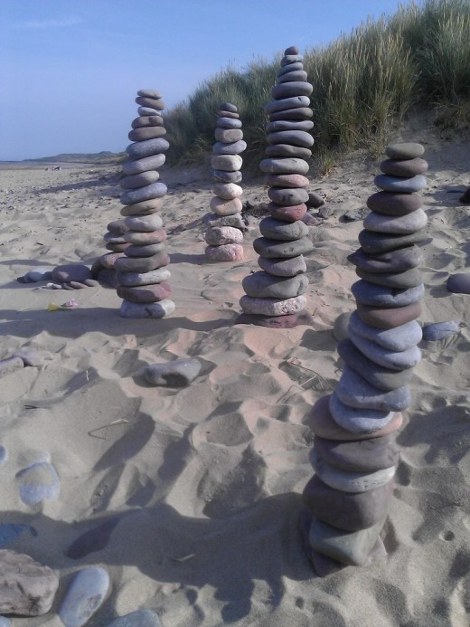 This is my wife's homage to the art of Chris Drury - also on the beach at Rhossili at about 6 in the morning.