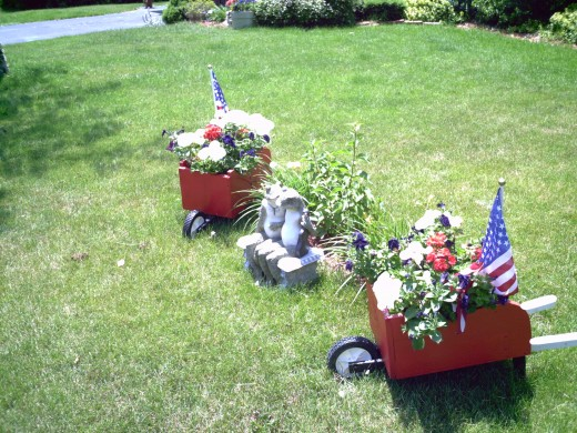 My handmade wheelbarrow patriotic flower displays.