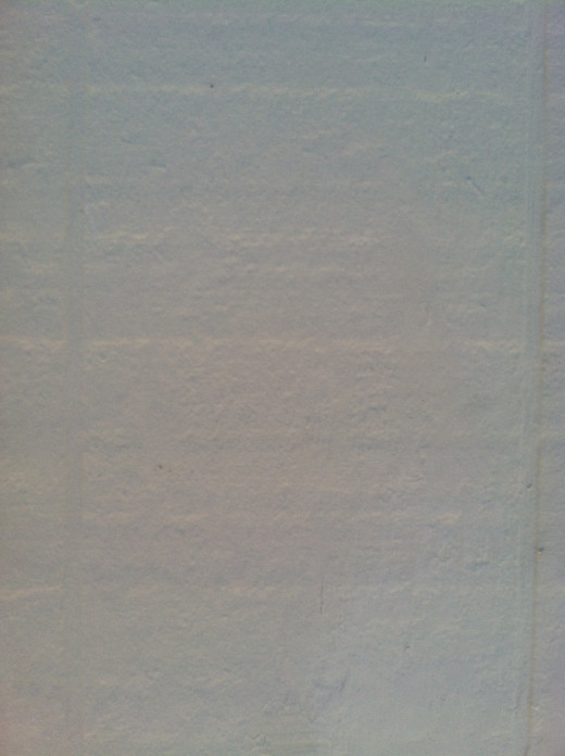 Spackle and paint help renew the home's siding.