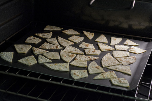 Lay them all out evenly on a cookie sheet to put into the oven.