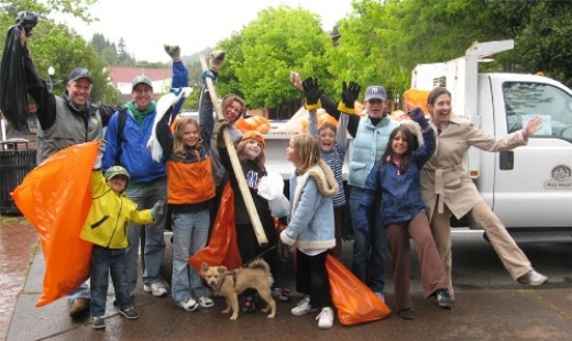 Volunteers from Old Mill School celebrate Earth Day by picking up trash in the Plaza