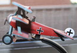 A model of a German World war One Tri-plane. It has the color of the infamous Red Baron.