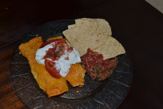 Top with sour cream and homemade salsa.