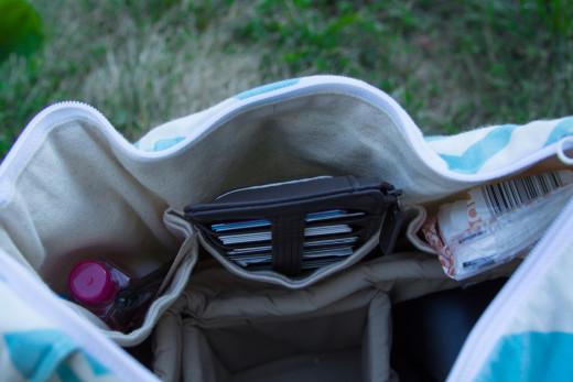 I have three deep interior pockets in my SLR camera bag.